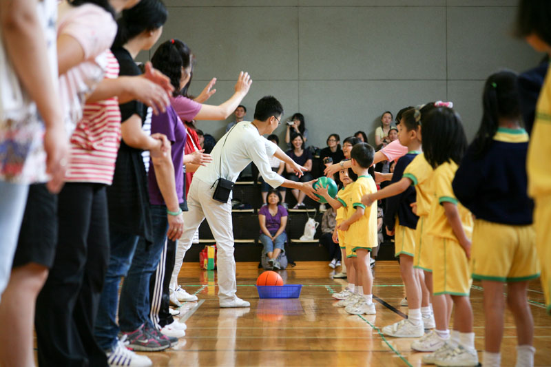 Parents and children are participating in physical games