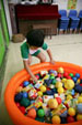 A child is looking for the answer from the ball pool